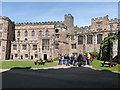 NZ2742 : Party of tourists being taken on a guided tour of Durham Castle by Derek Voller