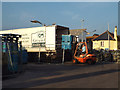 SX9372 : Fish packed in ice being loaded into a refrigerated lorry, Fish Quay, Teignmouth by Robin Stott