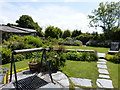SX0588 : Garden at the Old Post Office by don cload