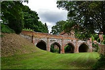 TL7835 : Castle Hedingham: The bridge over the dry moat by Michael Garlick