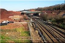 SX8769 : New road crossing railway, Aller by Derek Harper