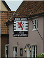 TM0485 : The Red Lion Public House sign by Adrian Cable