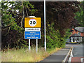 SN9079 : Llangurig Village Name sign on the A44 by Adrian Cable