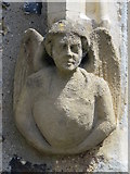 TL3706 : Stone angel by the west door of the Church of St. Augustine, Broxbourne by Mike Quinn