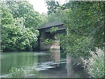 SU9778 : Railway bridge across the River Thames by Tim Glover