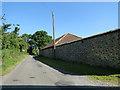 TG3826 : Flint wall and barn at Grange Farm, Ingham by Adrian S Pye