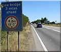 SP5721 : Low bridge 3 miles ahead sign, Bicester by Jaggery
