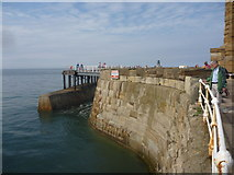NZ8911 : Whitby Townscape : Curved Masonry On The West Pier by Richard West