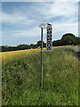TG1823 : Marsham Village Name sign on High Street by Geographer