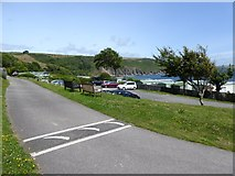 SX5646 : Part of Stoke Beach caravan park and the bay by David Smith