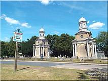 TM1131 : Mistley Towers and village sign by Malc McDonald