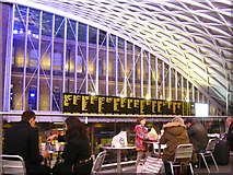 TQ3083 : Balcony view of the Departures board, Kings Cross station, London by Robin Stott