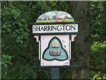 TG0337 : Sharrington village sign (detail) by Adrian S Pye