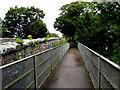 SN0100 : Railway footbridge alongside the A4139 bridge in Lamphey by Jaggery
