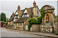 ST9168 : 1 West Street and Lacock War Memorial by Ian Capper