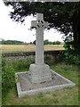 TG0135 : Gunthorpe War Memorial in the churchyard by Adrian S Pye