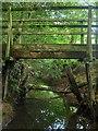 TQ3029 : Footbridge over Unnamed Stream by Simon Carey