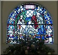 TQ0213 : St Michael - Window in top of door arch by Rob Farrow