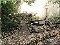 SE2535 : Hollybush Conservation Centre: logpile by Stephen Craven