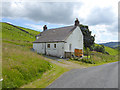 NY2993 : Roadside cottage by Oliver Dixon