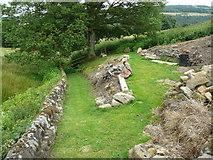 SE0322 : Sowerby bridge FP142, Link D, in a garden by Humphrey Bolton