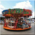 SJ9494 : Children's carousel by Gerald England