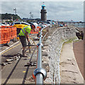 SX9372 : Repairing the handrail and footway at the Point, following winter storms, Teignmouth by Robin Stott
