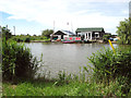 TG4319 : Bungalow and boat shed on the River Thurne by Evelyn Simak