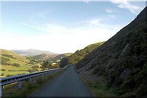 SH9124 : Road hugging the slopes of Craig yr Ogof by John Firth