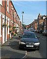 SK5738 : Flower baskets in Glapton Road by John Sutton