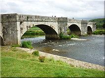SE0361 : Burnsall Bridge from the village green by Carroll Pierce