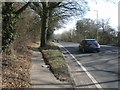 SU5666 : Footway alongside trees in the verge, eastbound A4 approaching Woolhampton by Robin Stott