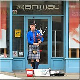 SH7882 : The Travelling Bagpiper by Gerald England