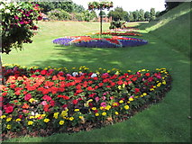 TL9925 : Colchester - Flower borders in Castle Park by Colin Park