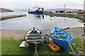 HU5499 : Boats big and small at Gutcher by Des Blenkinsopp