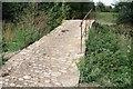 SP2437 : Restored Packhorse Bridge by Philip Halling