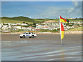 SS4543 : RNLI vehicle and bathing flags on Woolacombe Sand by Gary Rogers