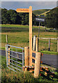 NT2624 : A signpost and stile by the A708 at Kirkstead by Walter Baxter