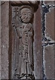 SO4430 : Kilpeck: The church of St. Mary and St. David : Carving of saint on north chancel arch column by Michael Garlick