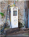 TL9734 : Old fuel pump seen in  an outbuilding, Nayland by Roger Jones