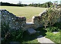 SZ7798 : Stile in the wall of West Wittering churchyard by Rob Farrow