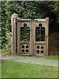 TQ1450 : Churchyard gate, Ranmore by Stefan Czapski