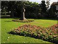 SE2634 : Celtic cross and flower beds, Gotts Park by Stephen Craven