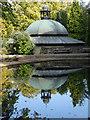 SE2955 : The café in Harrogate's Valley Gardens reflected in the model boating lake by Steve  Fareham