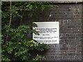 TQ6195 : Alexander Lane (North) Railway Bridge sign by Adrian Cable