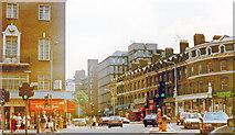 TQ2375 : Putney, 1989: crossroads of Upper Richmond Road and High Street by Ben Brooksbank