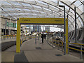 SJ8498 : Manchester Victoria station: approach to tram stop by Stephen Craven