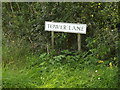 TM1164 : Tower Lane sign by Adrian Cable