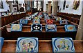 TM1179 : Diss: St. Mary the Virgin Church: The nave with its impressive display of kneelers by Michael Garlick