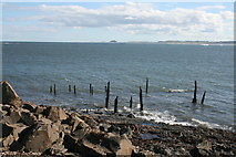 NU1341 : Shoreline by Lindisfarne Castle looking towards Bamburgh Castle by I Love Colour